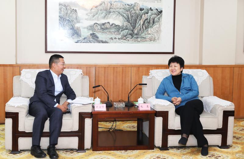 包惠访问华润燃气总裁史宝峰